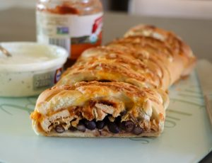 Photo of Chicken Taco Braid recipe served with salsa and sour cream.