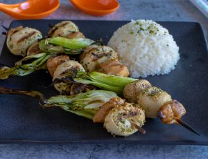 Asian Chicken Skewers on plate with rice.
